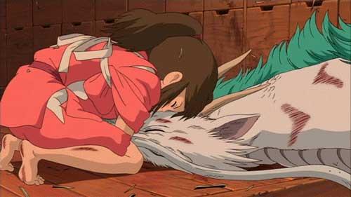 Chihiro ayudando a Haku